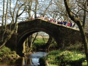 Walkers on a bridge